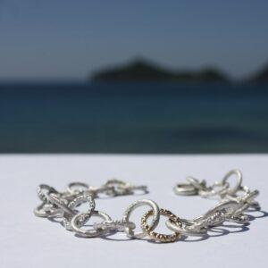 Armkette Silberringe Goldelement fein